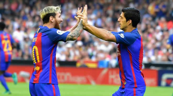 Lionel Messi dan Luis Suarez